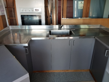 Compact modern kitchens with stainless steel top